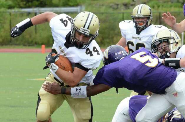 Westhill's Dylan Moye (5) stops Trumbull's Don Cherry (44) during the football game at Westhill High School in Stamford on Saturday, Sept. 24, 2011. Photo: Amy Mortensen / Connecticut Post Freelance