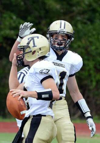 Trumbull's Daniel Paolino slaps teammate Brendan Moore on the helmet following Moore's touchdown during the football game against Westhill at Westhill High School in Stamford on Saturday, Sept. 24, 2011. Photo: Amy Mortensen / Connecticut Post Freelance