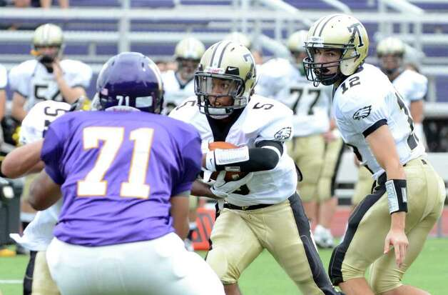 Trumbull's J.J. Smart (5) carries the ball during the football game against Westhill at Westhill High School in Stamford on Saturday, Sept. 24, 2011. Photo: Amy Mortensen / Connecticut Post Freelance