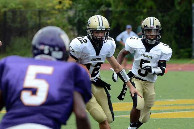 Trumbull's Brendan Moore and J.J. Smart (5) size up the defense during the football game against Westhill at Westhill High School in Stamford on Saturday, Sept. 24, 2011. Photo: Amy Mortensen / Connecticut Post Freelance