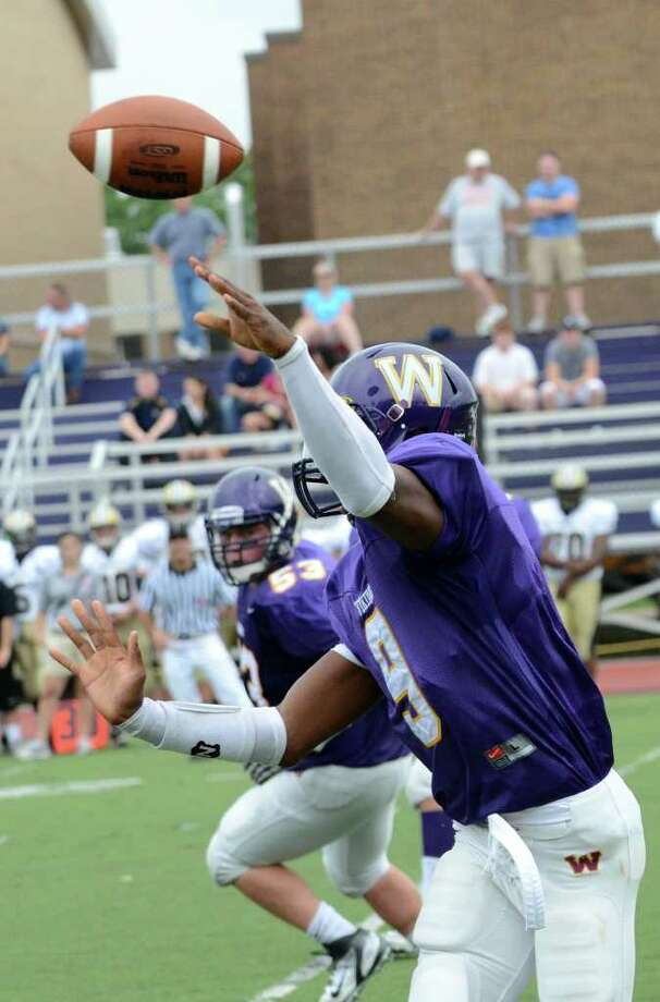 Westhill's RJ Cooper throws a pass during the football game against Trumbull at Westhill High School in Stamford on Saturday, Sept. 24, 2011. Photo: Amy Mortensen / Connecticut Post Freelance
