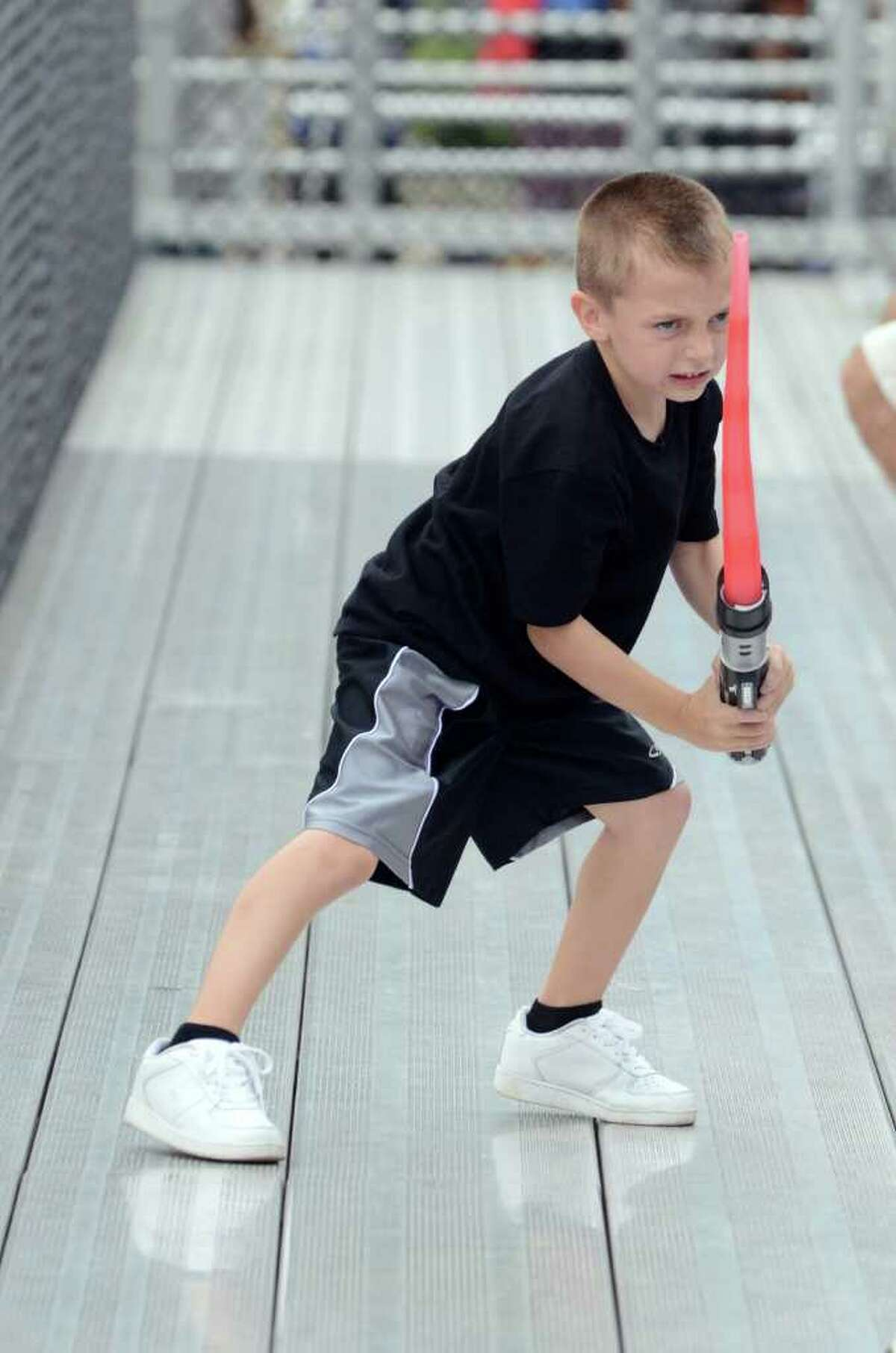 Giancarlo Montanaro, 6, of Trumbull wields his lightsaber in the stands during the Westhill vs Trumbull football game at Westhill High School in Stamford on Saturday, Sept. 24, 2011.