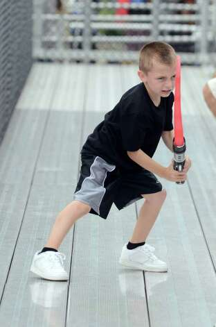 Giancarlo Montanaro, 6, of Trumbull wields his lightsaber in the stands during the Westhill vs Trumbull football game at Westhill High School in Stamford on Saturday, Sept. 24, 2011. Photo: Amy Mortensen / Connecticut Post Freelance