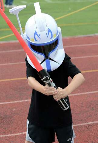Giancarlo Montanaro, 6, of Trumbull wields his lightsaber during the Westhill vs Trumbull football game at Westhill High School in Stamford on Saturday, Sept. 24, 2011. Photo: Amy Mortensen / Connecticut Post Freelance