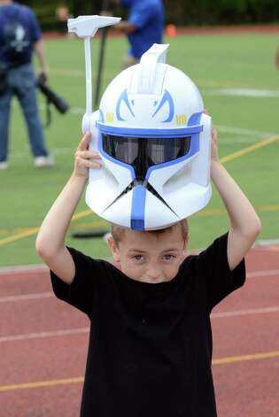 Giancarlo Montanaro, 6, of Trumbull peeks out from under his clone tropper helmet during the Westhill vs Trumbull football game at Westhill High School in Stamford on Saturday, Sept. 24, 2011. Photo: Amy Mortensen / Connecticut Post Freelance
