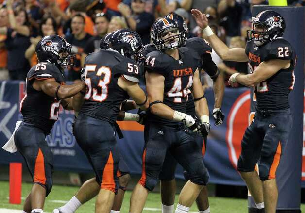 UTSA's Steven Kurfehs (44) gets congratulated by teammates after intercepting a pass and running in for a touchdown against Bacone in the first half at the Alamodome on Saturday, Sept. 24, 2011. Kin Man Hui/kmhui@express-news.net Photo: KIN MAN HUI, Express-News / SAN ANTONIO EXPRESS-NEWS