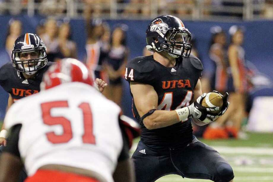 UTSA's Steven Kurfehs (44) intercepts a pass and eventually ran in for a touchdown against Bacone in the first half at the Alamodome on Saturday, Sept. 24, 2011. Kin Man Hui/kmhui@express-news.net Photo: KIN MAN HUI, Express-News / SAN ANTONIO EXPRESS-NEWS