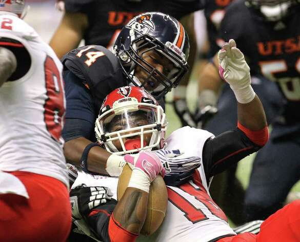 UTSA's Travis Menn (14) makes a tackle against Bacone's Tyler Thomas (18) in the first half at the Alamodome on Saturday, Sept. 24, 2011. Kin Man Hui/kmhui@express-news.net Photo: KIN MAN HUI, Express-News / SAN ANTONIO EXPRESS-NEWS