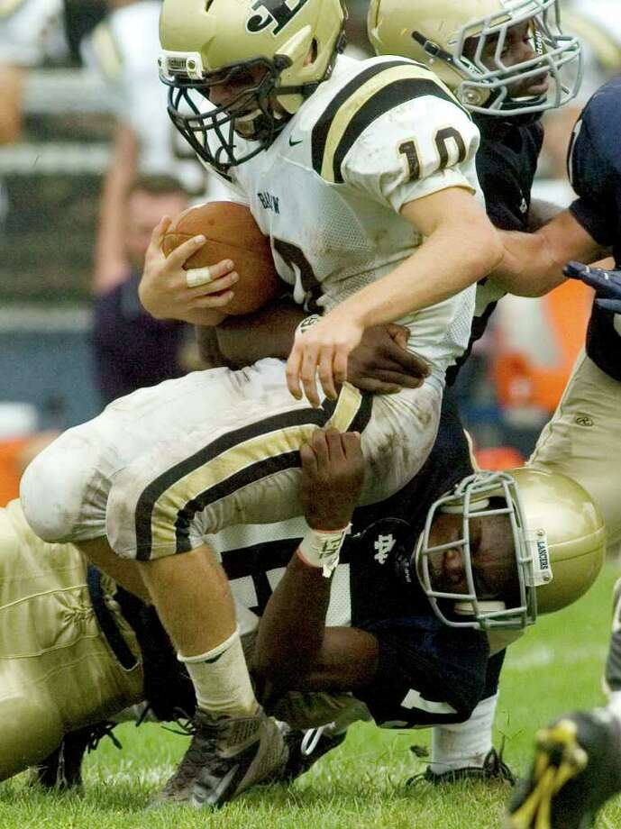 Joel Barlow's Jack Shaban is brought down by Notre Dame's Glody Tumba, bottom, during their game at Notre Dame Catholic High School in Fairfield on Saturday, Sept. 24, 2011. Photo: Jason Rearick / The News-Times