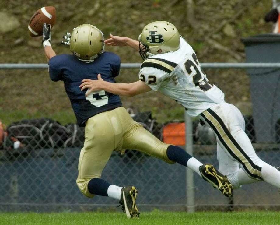 Notre Dame's Matt Moffat, left, and Joel Barlow's Alex Lockwood compete for the reception intended for Moffat during their game at Notre Dame Catholic High School in Fairfield on Saturday, Sept. 24, 2011. Photo: Jason Rearick / The News-Times