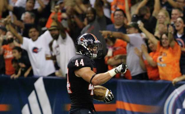 UTSA's Steven Kurfehs (44) reacts after scoring a touchdown on an interception against Bacone in the first half at the Alamodome on Saturday, Sept. 24, 2011. Kin Man Hui/kmhui@express-news.net Photo: KIN MAN HUI, Express-News / SAN ANTONIO EXPRESS-NEWS