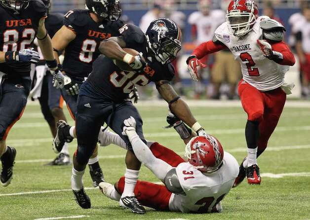 UTSA's Evans Okotcha (36) runs over Bacone's James Ralston (31) in the second half at the Alamodome on Saturday, Sept. 24, 2011. UTSA defeated Bacone, 54-7. Kin Man Hui/kmhui@express-news.net Photo: KIN MAN HUI, Express-News / SAN ANTONIO EXPRESS-NEWS