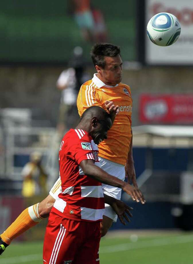 Dynamo 1, FC Dallas 0: Jair Benitez #5 of FC Dallas jumps for the header with Danny Cruz #5 of the Houston Dynamo at Pizza Hut Park on September 24, 2011 in Frisco, Texas. Photo: Ronald Martinez, Getty / 2011 Getty Images