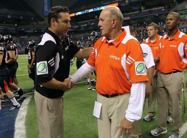 UTSA head coach Larry Coker (right) shakes hands with Bacone's Trevor Rubly at the end of their game at the Alamodome on Saturday, Sept. 24, 2011. UTSA defeated Bacone, 54-7. Kin Man Hui/kmhui@express-news.net Photo: KIN MAN HUI, Express-News / SAN ANTONIO EXPRESS-NEWS