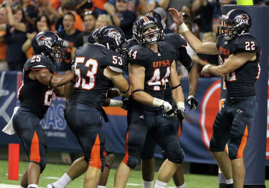 UTSA's Steven Kurfehs (44) gets congratulated by teammates after intercepting a pass and running in for a touchdown against Bacone in the first half at the Alamodome on Saturday, Sept. 24, 2011. Kin Man Hui/kmhui@express-news.net Photo: KIN MAN HUI, / / SAN ANTONIO EXPRESS-NEWS