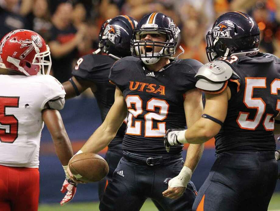 UTSA's Nic Johnson (22) reacts after recovering a fumble against Bacone in the first half at the Alamodome on Saturday, Sept. 24, 2011. Kin Man Hui/kmhui@express-news.net Photo: KIN MAN HUI, / / SAN ANTONIO EXPRESS-NEWS