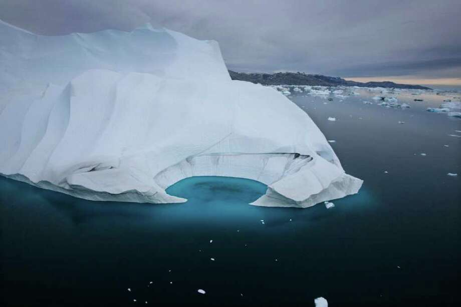 JOHN MCCONNICO : ASSOCIATED PRESS FILE OOPS: This iceberg is melting off the coast of Ammasalik, Greenland, but a claim in a new atlas that Greenland has lost 15 percent of its ice cover is wrong, scientists insist. Photo: JOHN MCCONNICO / AP