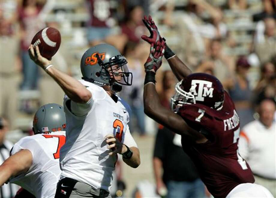 Oklahoma State quarterback Brandon Weeden (3) throws a pass as he is pressured by Texas A&M defensive back Terrence Frederick (7) during the second quarter of an NCAA college football game Saturday, Sept. 24, 2011, in College Station, Texas. (AP Photo/David J. Phillip) Photo: Associated Press