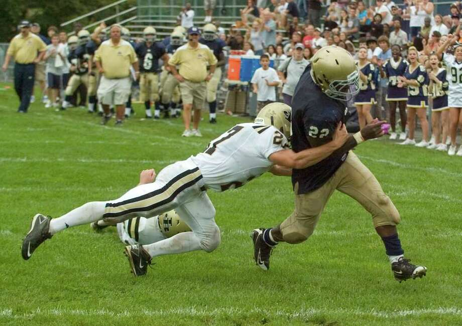 Joel Barlow's Samuel Reed tries to bring down Notre Dame's Nigel Beckford during their game at Notre Dame Catholic High School in Fairfield on Saturday, Sept. 24, 2011.  Beckford ran the ball in for a touchdown. Photo: Jason Rearick / The News-Times
