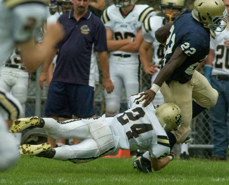 Notre Dame's Nigel Bickford gets tripped up by Joel Barlow's Andrew Bindelglass during their game at Notre Dame Catholic High School in Fairfield on Saturday, Sept. 24, 2011. Photo: Jason Rearick / The News-Times