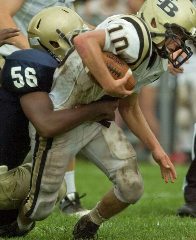 Notre Dame's Jalani Roman tries to bring down Joel Barlow's quarterback Jack Shaban during their game at Notre Dame Catholic High School in Fairfield on Saturday, Sept. 24, 2011. Photo: Jason Rearick / The News-Times