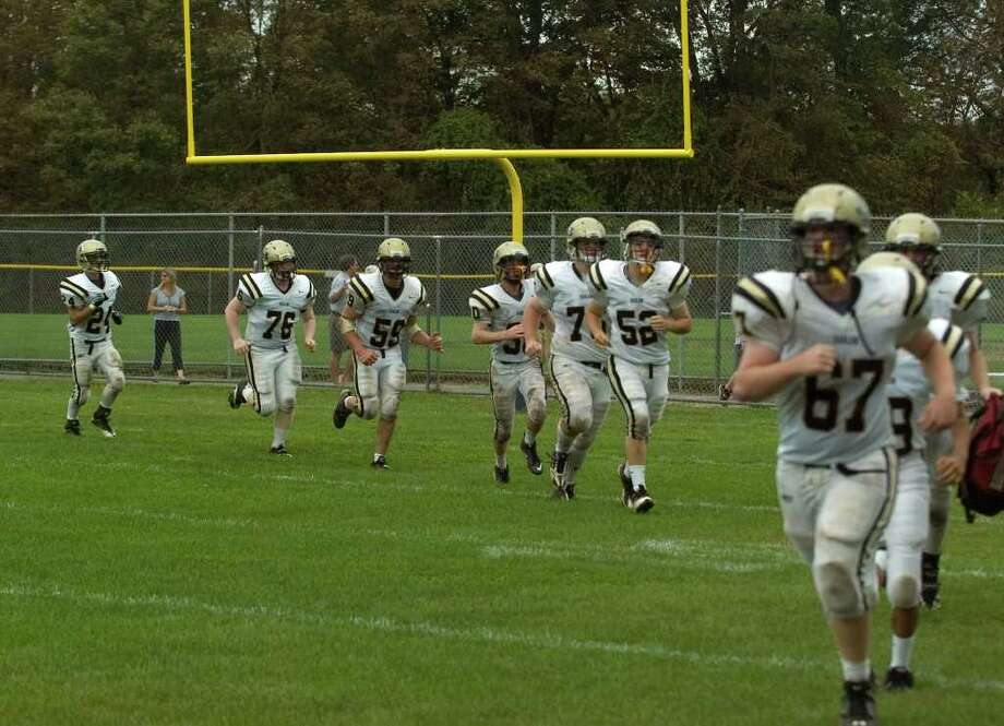 Joel Barlow players return after the half of their game against Notre Dame at Notre Dame Catholic High School in Fairfield on Saturday, Sept. 24, 2011. Photo: Jason Rearick / The News-Times