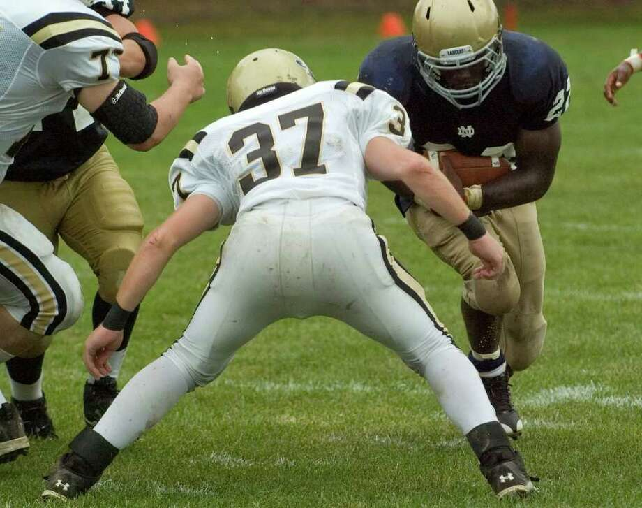 Joel Barlow's Scott Colby, foreground, readies to hit Notre Dame's Nigel Beckford during their game at Notre Dame Catholic High School in Fairfield on Saturday, Sept. 24, 2011. Photo: Jason Rearick / The News-Times