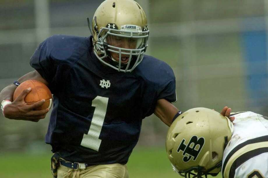 Notre Dame's Daquan Coleman keeps Joel Barlow's Joel Barlow's Jack Shaban away during a run during their game at Notre Dame Catholic High School in Fairfield on Saturday, Sept. 24, 2011. Photo: Jason Rearick / The News-Times