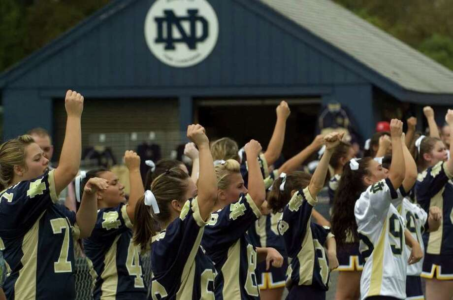 Notre Dame cheerleaders try to pump up the crowd during their game against Joel Barlow at Notre Dame Catholic High School in Fairfield on Saturday, Sept. 24, 2011. Photo: Jason Rearick / The News-Times