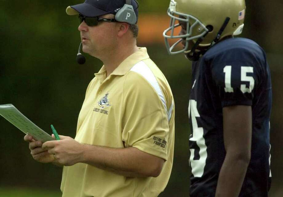 Notre Dame head coach Rico Brogna talks with his quarterback, Glody Tumba, during their game against Joel Barlow at Notre Dame Catholic High School in Fairfield on Saturday, Sept. 24, 2011. Photo: Jason Rearick / The News-Times