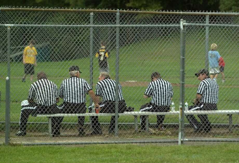 Football officials take a break during halftime of the Joel Barlow / Notre Dame game at Notre Dame Catholic High School in Fairfield on Saturday, Sept. 24, 2011. Photo: Jason Rearick / The News-Times