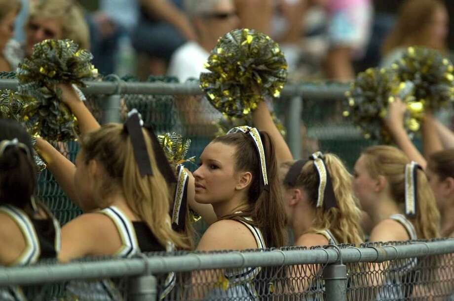 Joel Barlow cheerleaders try to pump up the crowd during their game against Notre Dame at Notre Dame Catholic High School in Fairfield on Saturday, Sept. 24, 2011. Photo: Jason Rearick / The News-Times