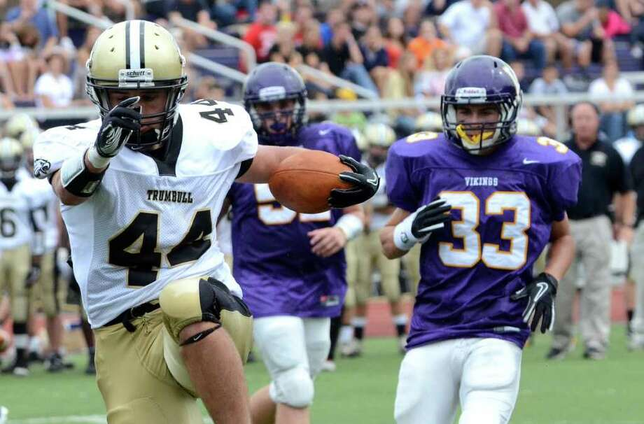 Trumbull's Don Cherry (44) runs for a touchdown during the football game against Westhill at Westhill High School in Stamford on Saturday, Sept. 24, 2011. Photo: Amy Mortensen / Connecticut Post Freelance