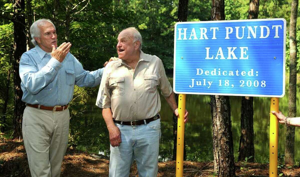 JERRY BAKER : CHRONICLE FILE GREEN REPUTATION: Harris County Precinct 4 Commissioner Jerry Eversole, left, celebrates with John Pundt in July 2008 after the sign dedicating Hart Pundt Lake was unveiled during the opening of the 380-acre John Pundt Park in Spring.