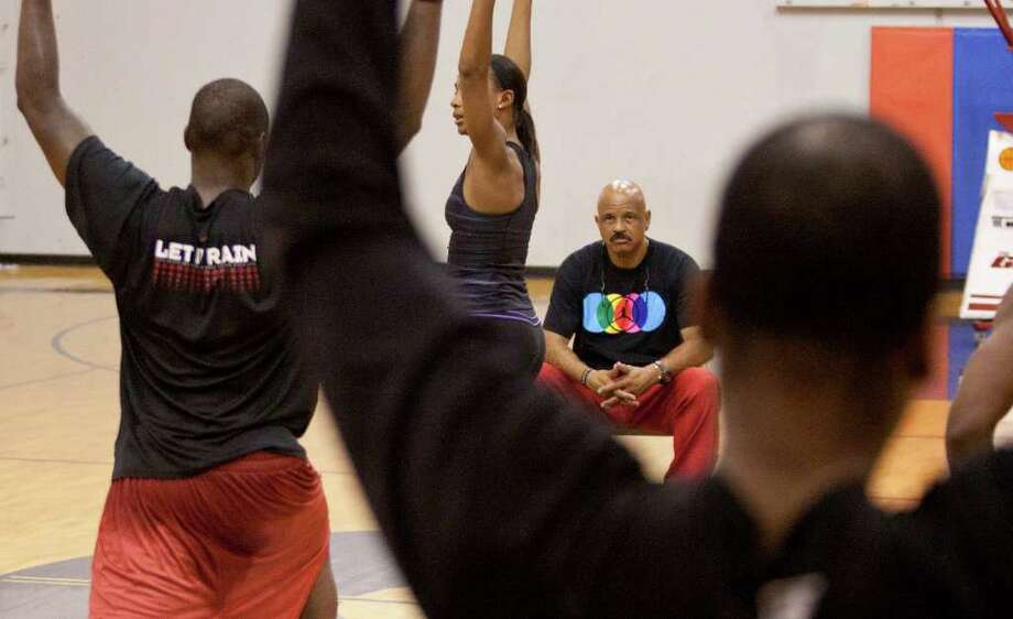 John Lucas, center, watches as Monique Dotson conducts yoga exercises twice a week as part of Lucas' multifaceted basketball training program at Lutheran North High School. Photo: For The Chronicle:  Thomas B. Sh