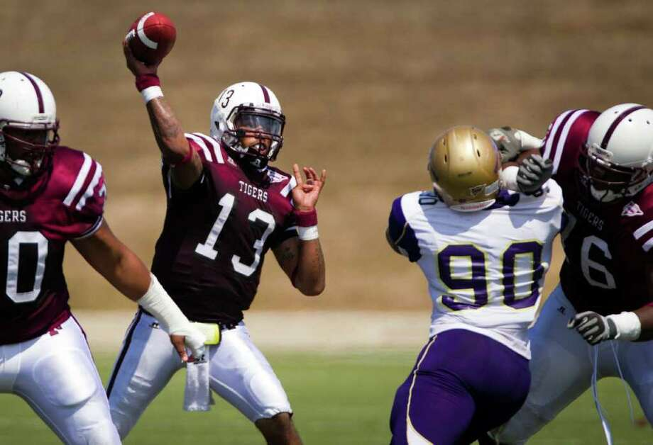Texas Southern Tigers quarterback Rico Smalls (13) fires a pass during the first half in an NCAA football game against the Alcorn State Braves at Delmar Stadium, Saturday, Sept. 24, 2011, in Houston. Photo: Smiley N. Pool, Houston Chronicle / © 2011  Houston Chronicle