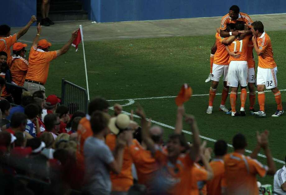 RONALD MARTINEZ : GETTY IMAGES FILE TRAVELING PARTY: The Dynamo had plenty to celebrate late in the regular season, starting with this goal in a win - their first away from home this year - over FC Dallas on Sept. 24. Photo: Ronald Martinez / 2011 Getty Images
