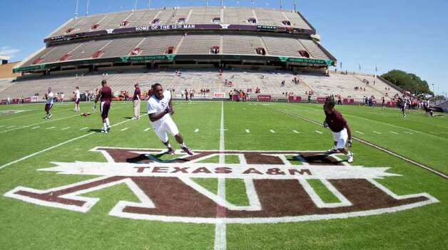 Texas A&M players warm up for their game against Oklahoma State, Saturday, Sept. 24, 2011, in Kyle Field in College Station. Photo: Nick De La Torre, Houston Chronicle / © 2011 Houston Chronicle
