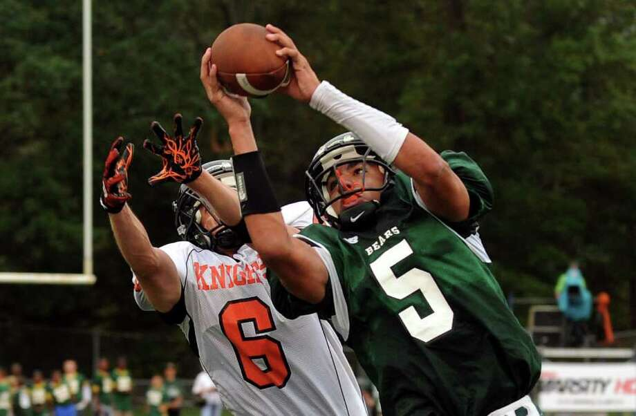 A pass intended for Stamford's #6 Greg Lupinacci, left, in intercepted by Norwalk's #5 Delshawn Wilson, during boys football action in Norwalk, Conn. on Saturday September 24, 2011. Photo: Christian Abraham / Connecticut Post