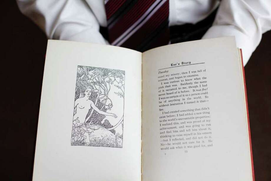 EVAN McGLINN : NEW YORK TIMES A READER: A copy of Eve's Diary by Mark Twain is now available at the Charlton Public Library in Charlton, Mass. Years ago, trustees objected to illustration of a naked Eve in Eden. Photo: EVAN MCGLINN / NYTNS