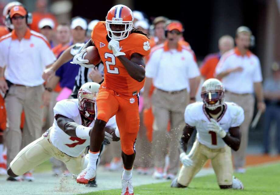 RICHARD SHIRO : ASSOCIATED PRESS CAN'T HOLD THAT TIGER: Clemson's Sammie Watkins gets away from Florida State's Christian Jones on one of Watkins' eight catches that covered 141 yards. Photo: RICHARD SHIRO / (2011) Richard Shiro