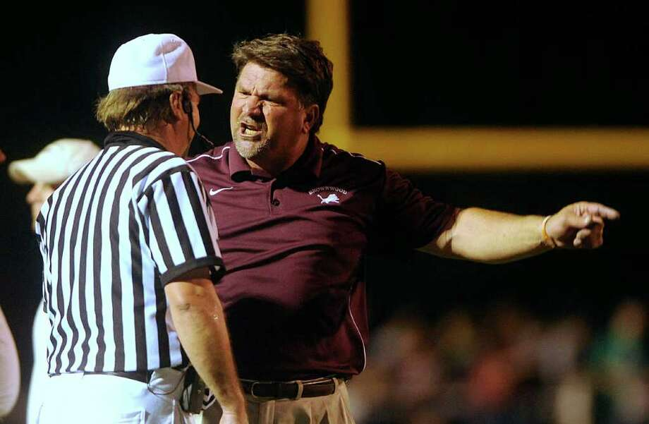 Brownwood head coach Bob Shipley, right, discusses a call with a referee during the fourth quarter of Brownwood's 49-16 win over Stephenville on Friday, Sept. 10, 2010, at Gordon Wood Stadium in Brownwood. (Photo by Tommy Metthe/Abilene Reporter-News) Photo: Tommy Metthe, Express-News / Tommy Metthe/Abilene Reporter-News