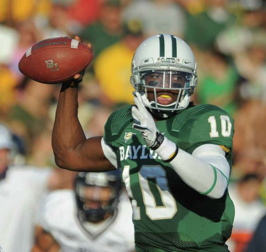 Baylor quarterback Robert Griffin III (10) throws against Rice in the first half of an NCAA college football game on Saturday, Sept. 24, 2011, in Waco, Texas. (AP Photo/ Rod Aydelotte) Photo: Rod Aydelotte, Associated Press / AP2011