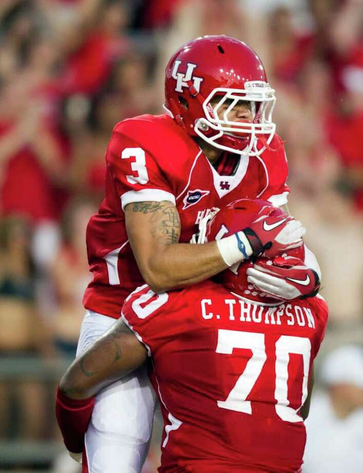 Houston Cougars wide receiver Justin Johnson (3) celebrates with offensive linesman Chris Thompson (70) after scoring a touchdown during the first half of an NCAA football game against the Georgia State Panthers at Robertson Stadium, Saturday, Sept. 24, 2011, in Houston. Photo: Smiley N. Pool, Houston Chronicle / © 2011  Houston Chronicle