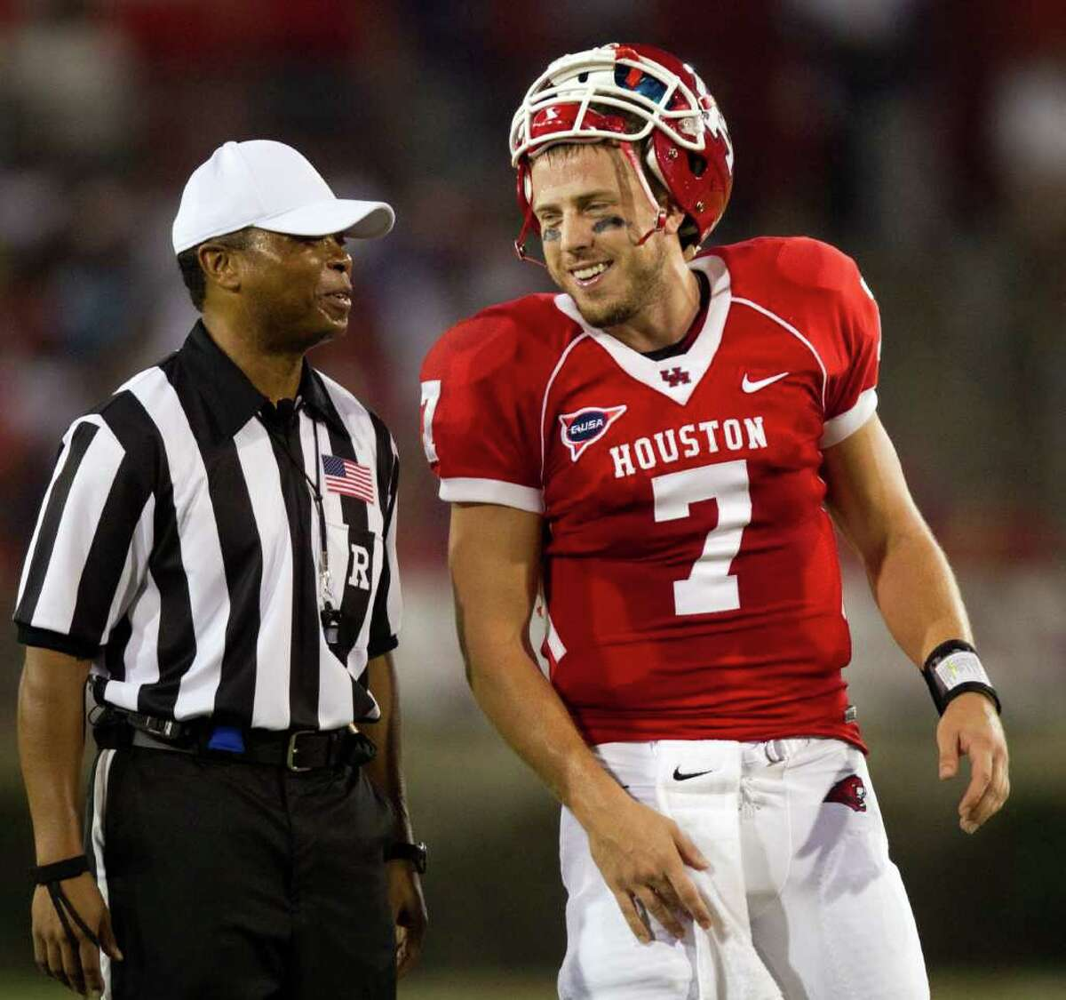 Houston Cougars quarterback Case Keenum (7) laughs with referee Jerry Banks during the first half of an NCAA football game against the Georgia State Panthers at Robertson Stadium, Saturday, Sept. 24, 2011, in Houston.