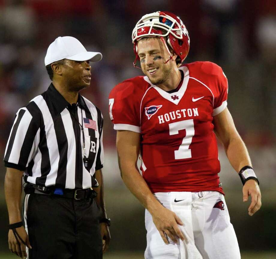 Houston Cougars quarterback Case Keenum (7) laughs with referee Jerry Banks during the first half of an NCAA football game against the Georgia State Panthers at Robertson Stadium, Saturday, Sept. 24, 2011, in Houston. Photo: Smiley N. Pool, Houston Chronicle / © 2011  Houston Chronicle