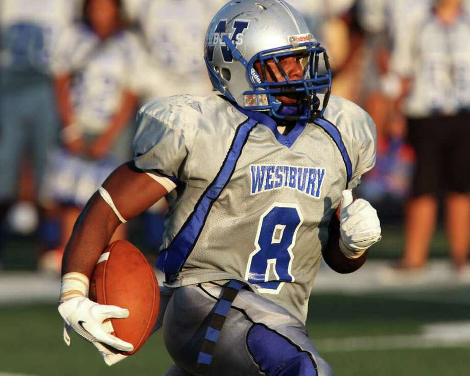 Halfback Jailin Singleton #9 of the Westbury Rebels rushes against the Westside Wolves of in a District 20-5A high school football game at Butler Stadium in Houston, Texas.: Thomas B. Shea Photo: For The Chronicle: Thomas B. She