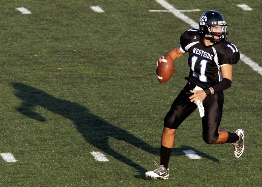 Quarterback Khaled Kazmi #11 of the Westside Wolves deep in the pocket against the Westbury Rebels in a District 20-5A high school football game at Butler Stadium in Houston, Texas.: Thomas B. Shea Photo: For The Chronicle: Thomas B. She
