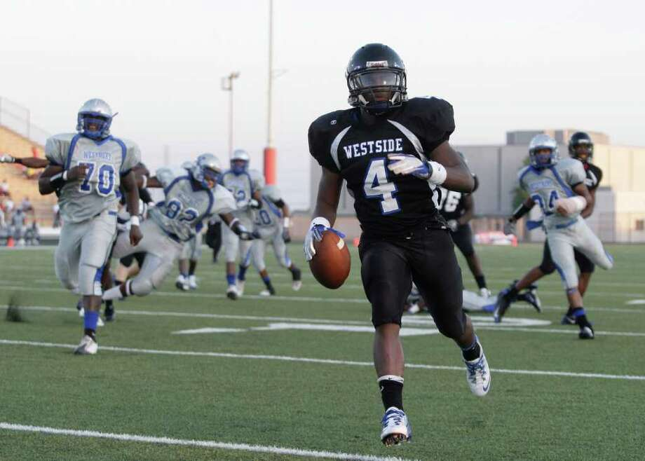 Sept. 24: Westside 56, Westbury 29. Running back B.J. Catalon #4 of the Westside Wolves  rushes for 32 yard touchdown against the Westbury Rebels in a District 20-5A high school football game at Butler Stadium in Houston, Texas.: Thomas B. Shea Photo: For The Chronicle: Thomas B. She