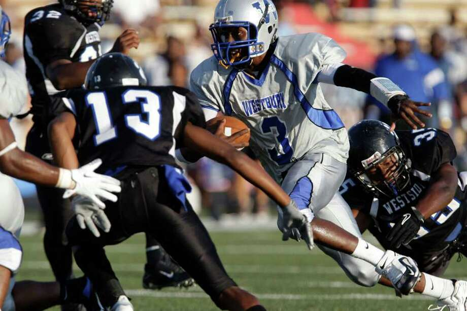 Quarterback Delvon Carpenter #3 of the Westbury Rebels rushes past defensive end Eric Alcee #35 of the Westside Wolves of in a District 20-5A high school football game at Butler Stadium in Houston, Texas.: Thomas B. Shea Photo: For The Chronicle: Thomas B. She
